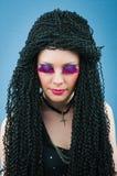 有卷曲理发的新可爱的女孩 免版税图库摄影