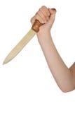有厨刀的手 免版税库存图片
