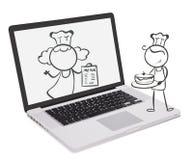 有厨师的图象的一台膝上型计算机 免版税图库摄影
