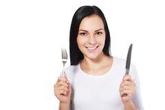 有叉子和刀子的妇女 图库摄影