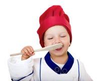 有叉子的小厨师 库存图片
