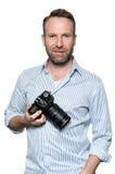 有友好的微笑的英俊的摄影师 免版税库存图片