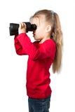 有双筒望远镜的女孩 库存图片