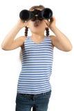 有双筒望远镜的小女孩 库存照片