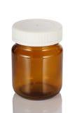 有反射的一个空的棕色玻璃药瓶。 库存图片