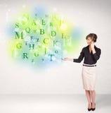 有发光的信件概念的女商人 免版税库存照片