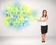 有发光的信件概念的女商人 免版税库存图片