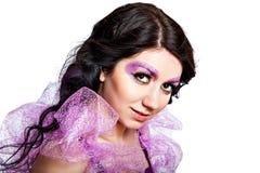 有发光的极端紫罗兰色金子构成的甜女孩 图库摄影