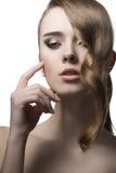 有发光的头发的秀丽女孩 免版税库存图片