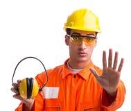 有取消耳机的噪声的建筑工人 免版税图库摄影