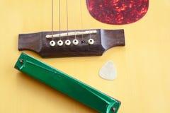 有口琴的吉他 免版税库存图片