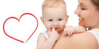 有可爱的婴孩的愉快的母亲 库存照片