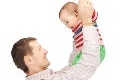 有可爱的婴孩的愉快的父亲 库存图片