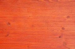 有可看见的树结构的被绘的红色委员会 库存照片