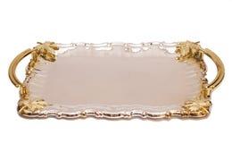 有叶子装饰品的空的银色盘子 库存照片