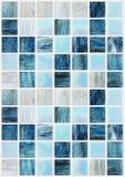 有各种各样的作用大理石的蓝色方形的瓦片 免版税图库摄影