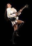 有吉他的一个少妇 免版税库存照片