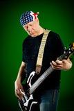 有吉他的人,低音演奏员 免版税库存图片