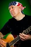 有吉他的人,低音演奏员 库存照片