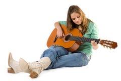 有吉他的女孩。 库存照片