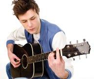有吉他的人 免版税库存照片
