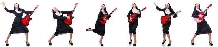有吉他的尼姑 免版税库存照片