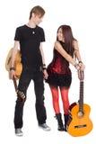 有吉他的年轻音乐家 免版税库存图片