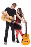 有吉他的年轻音乐家 库存照片