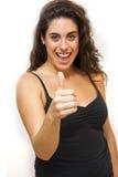 有向上拇指的美丽的妇女 免版税库存照片