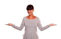 有向上掌上型计算机的微笑的少妇 免版税图库摄影