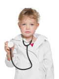 有听诊器的小女孩 库存照片