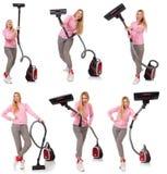 有吸尘器的少妇在白色 免版税图库摄影