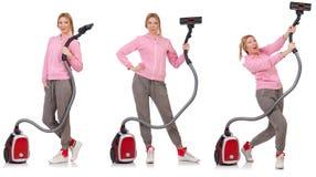 有吸尘器的少妇在白色 图库摄影