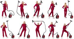 有吸尘器的少妇在白色 免版税库存图片