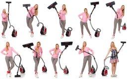 有吸尘器的少妇在白色 库存照片