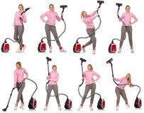 有吸尘器的少妇在白色 库存图片