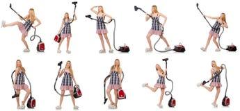 有吸尘器的少妇 免版税库存图片