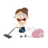 有吸尘器的愉快的妇女 免版税库存照片