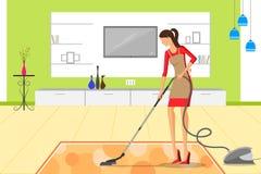 有吸尘器的美丽的妇女清洁房子 免版税库存图片