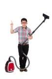 有吸尘器的滑稽的人 免版税库存照片