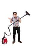 有吸尘器的滑稽的人 库存图片