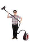 有吸尘器的滑稽的人 免版税图库摄影