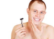 有吸引力的人刮脸微笑的年轻人 免版税库存图片