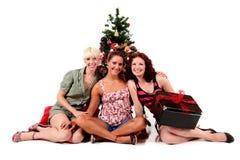 有吸引力的圣诞节新三名的妇女 免版税库存照片