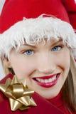 有吸引力的女孩存在圣诞老人 图库摄影