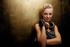 有吸引力的女孩耳机废物蒸汽 免版税库存照片