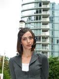 有吸引力的女实业家耳机年轻人 免版税图库摄影
