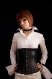 有吸引力的女衬衫束腰女孩皮革白色 免版税库存图片