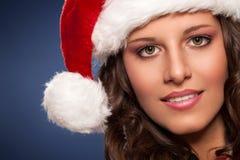 有吸引力的帽子圣诞老人妇女年轻人 库存照片