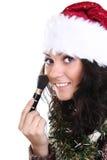 有吸引力的画笔女孩帽子组成圣诞老&# 图库摄影
